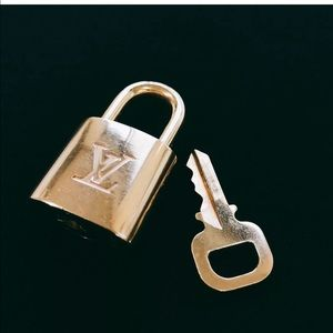 Authentic Louis Vuitton pad lock with matching key